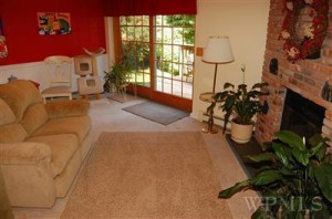 Home Staging brings Multiple Offers on a House - Basement Family Room listing picture