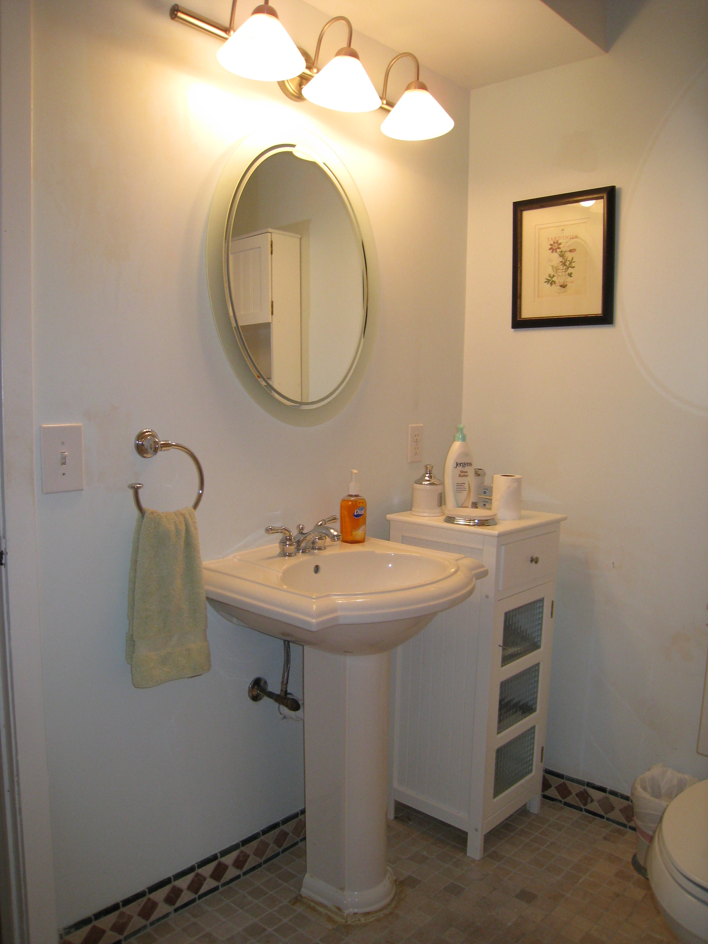Powder Room With Pedestal Sink Decorating Ideas from atwellstagedhome.com